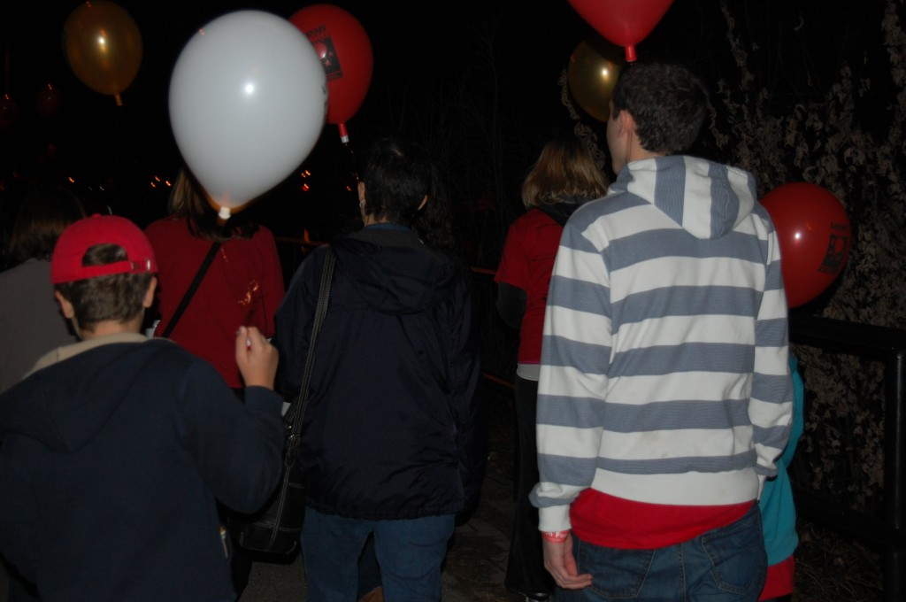 Balloons lit by electric candles highlight Light the Night walks.
