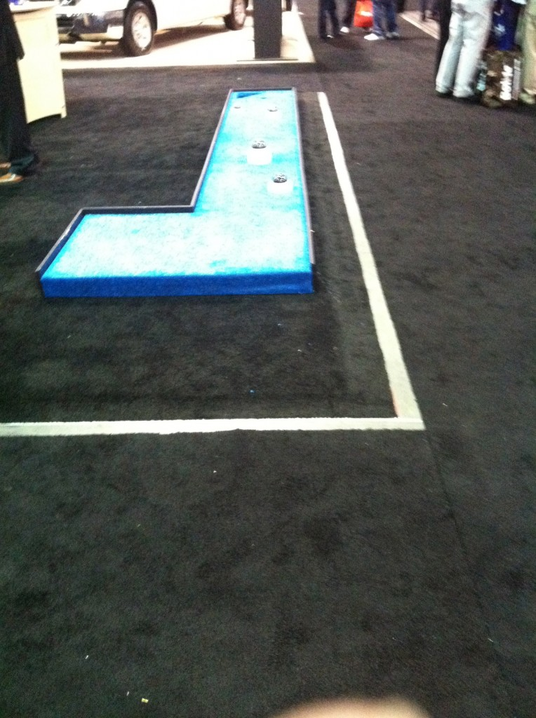 Probably not a good idea to use your products (CCTV cameras) as mini golf hazards in a trade show booth putting green.